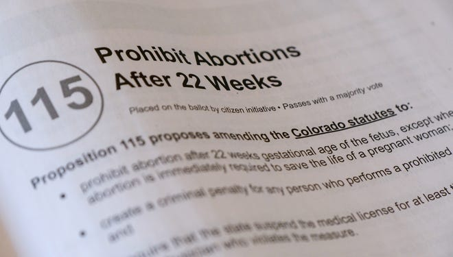 """Information on Proposition 115 in Colorado's 2020 """"blue book."""""""
