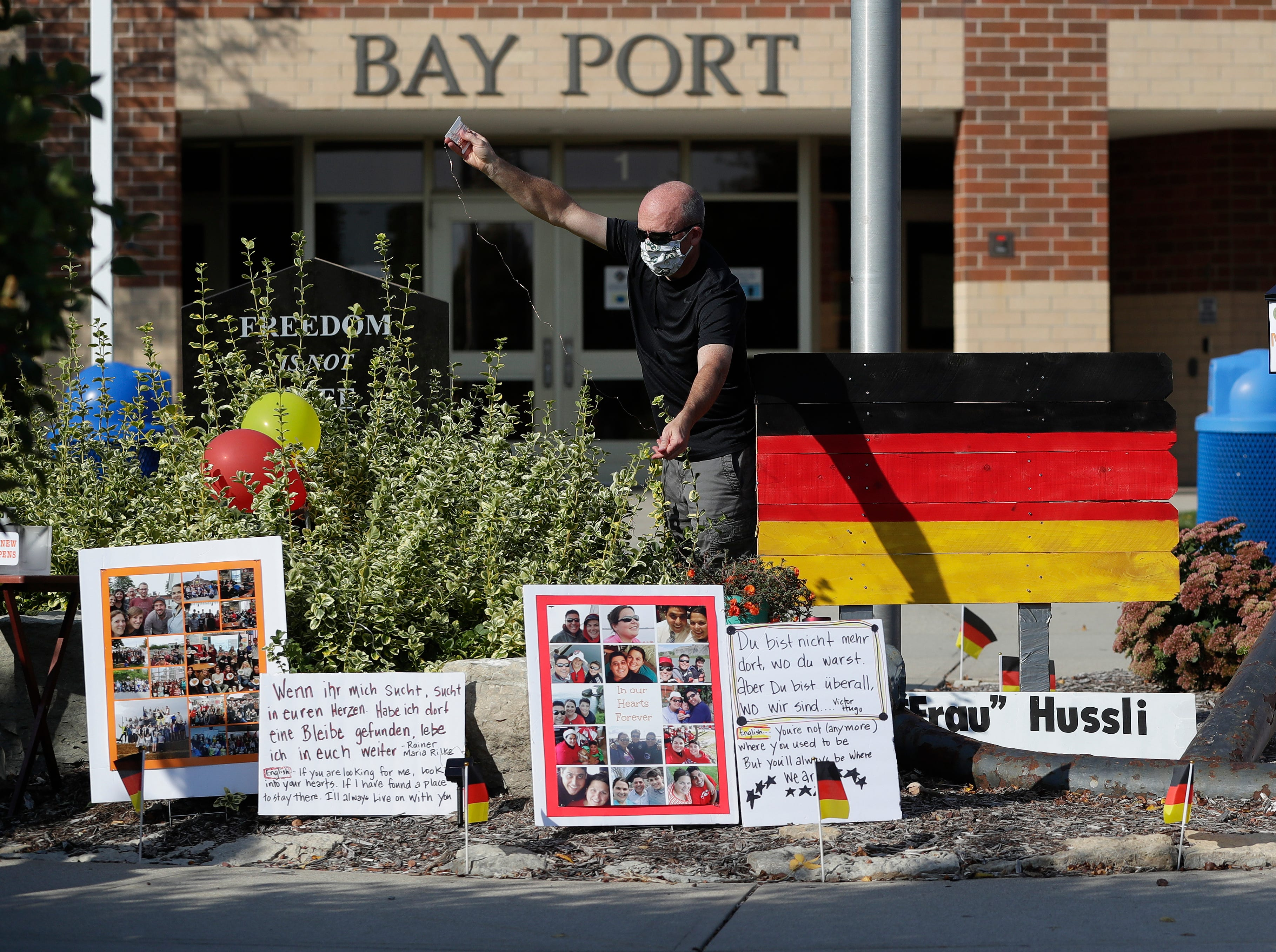 Family and friends set up a memorial outside Bay Port High School on Friday for Heidi Hussli, a German teacher who died from COVID-19 on Sept. 17, 2020.
