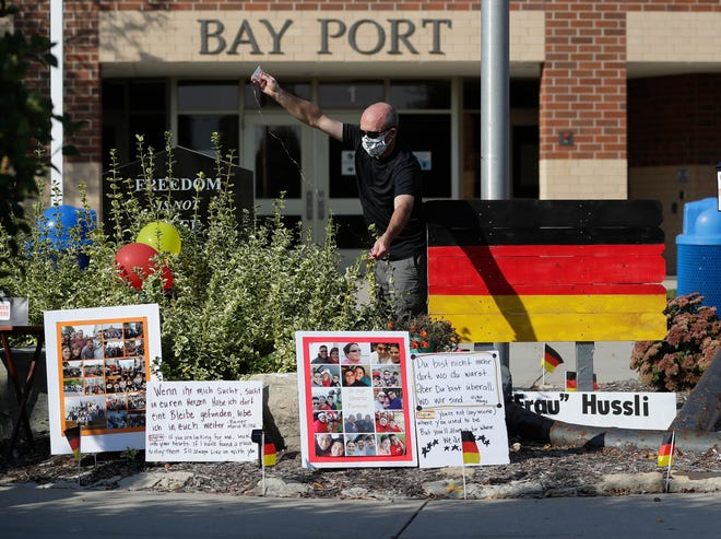 Family and friends set up a memorial outside Bay Port High School on Friday for Heidi Hussli, a German teacher who died from COVID-19 on Sept. 17. The district decided to close its schools and move all instruction online on Friday due to the spread of coronavirus in the community.