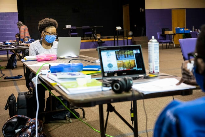 Kayla Mackey, 15,  does her homework at the Redeemed Christian Center in Jackson, Tenn., Thursday, Sept. 24, 2020. The campus is one of few virtual learning environments that offer families a safe and socially distanced space for children to do their school work when they can't at home.