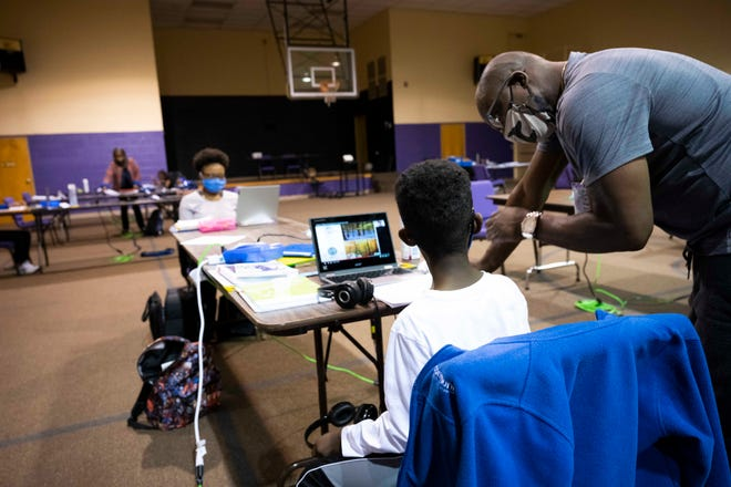 The Redeemed Christian Center in Jackson, Tenn., is one of few virtual learning environments that offer families a safe and socially distanced space for children to do their school work when they can't at home. Thursday, Sept. 24, 2020.