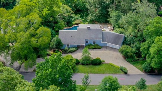 An aerial photo of a current home listing at 500 Cherokee Boulevard, captured with a drone. More agents are offering diverse imagery of home listings, along with 3D renderings and video flythroughs, to support clients during the pandemic.