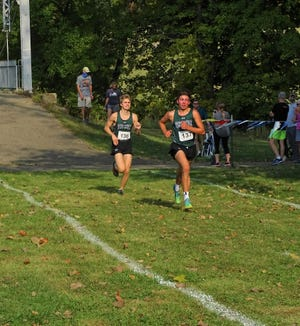 Fisher Catholic's Patrick Kenney and Aiden Jackson first first and second to help lead the Irish in their Division II/III win during Thursday's Bob Reall Cross Country Invitational.