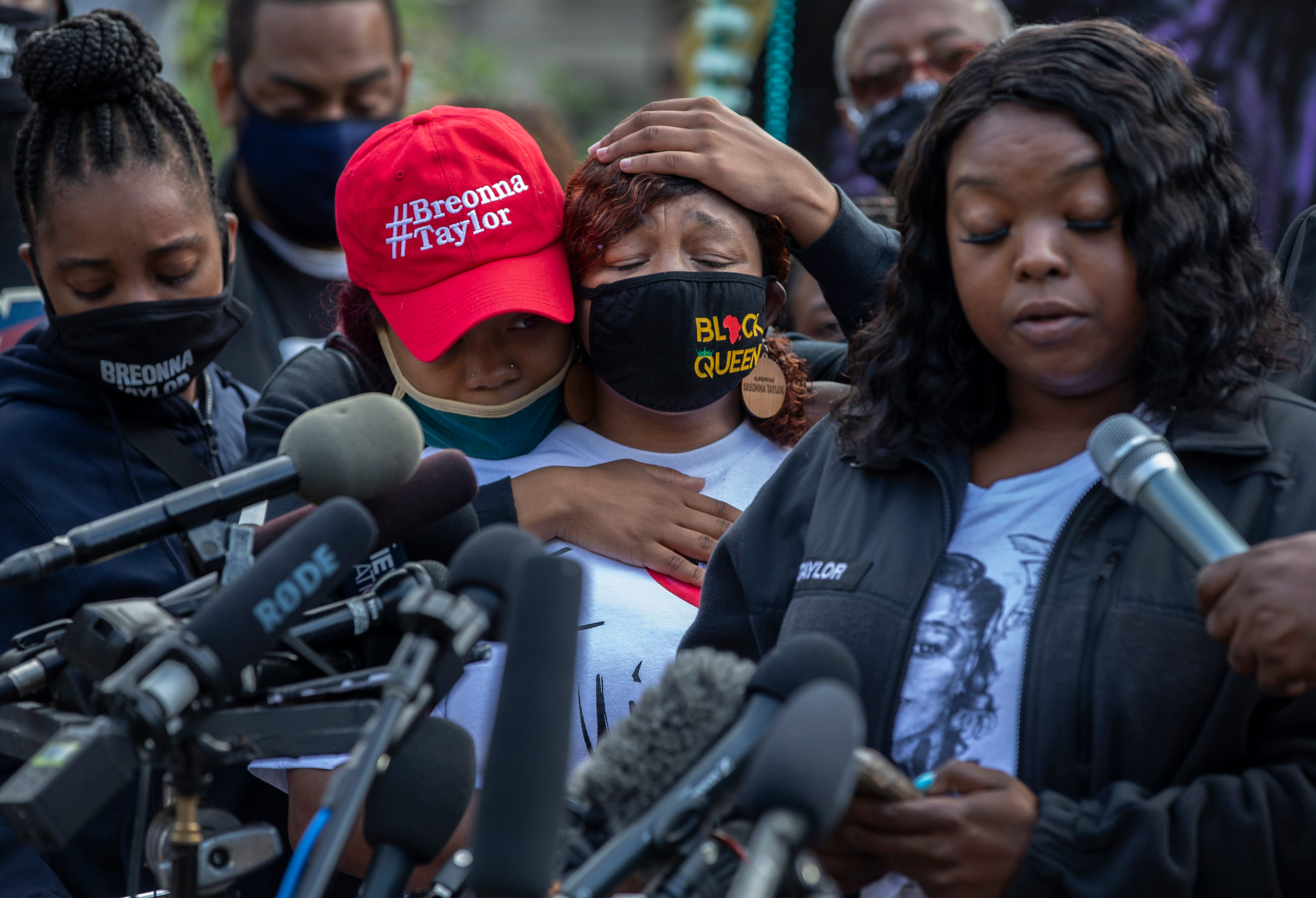 Tamika Palmer, mother of Breonna Taylor, is comforted by her daughter Juniyah, while listening to her sister Bianca Austin speak during a press conference. The gathering was called to refute the Kentucky Attorney General's grand jury's recommendations in Breonna Taylor's death. Sept. 25, 2020