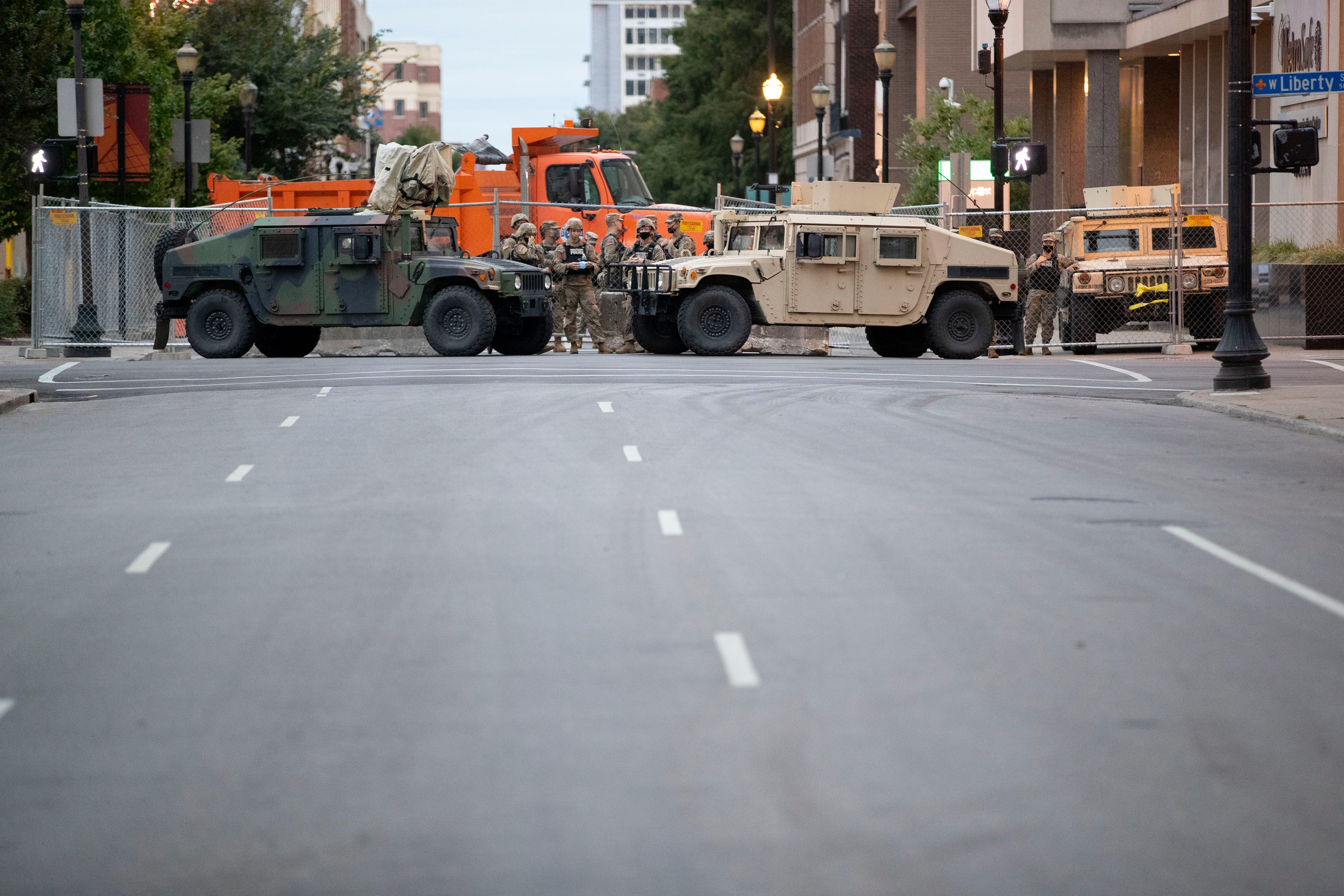 Kentucky National Guard stand at an intersection Thursday, Sept. 24, 2020, in downtown Louisville.