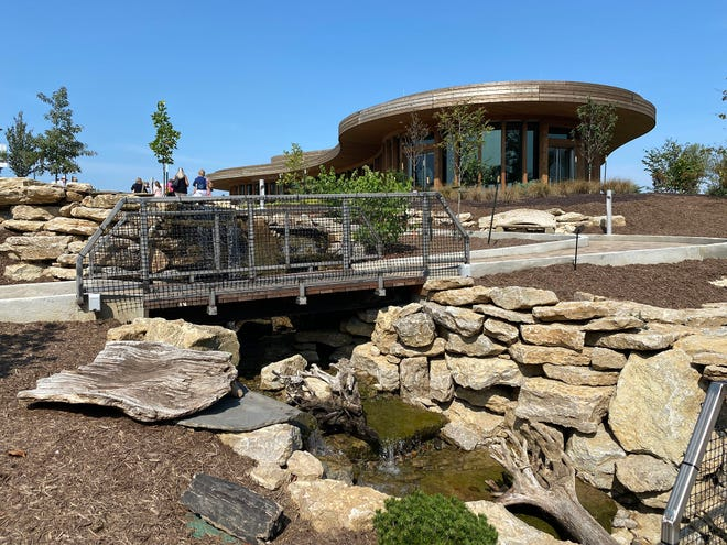 The Beargrass Creek Pathway winds up a hill and then enters onto the plaza in front of the Graeser Family Education Center in the Gardens.