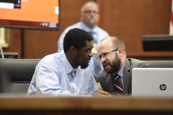 Chekiah Washington speaks with his defense attorney, Matthew Williams, Friday in Richland County Common Pleas Court. The jury will resume deliberations in Washington's rape trial at 9 a.m. Monday.