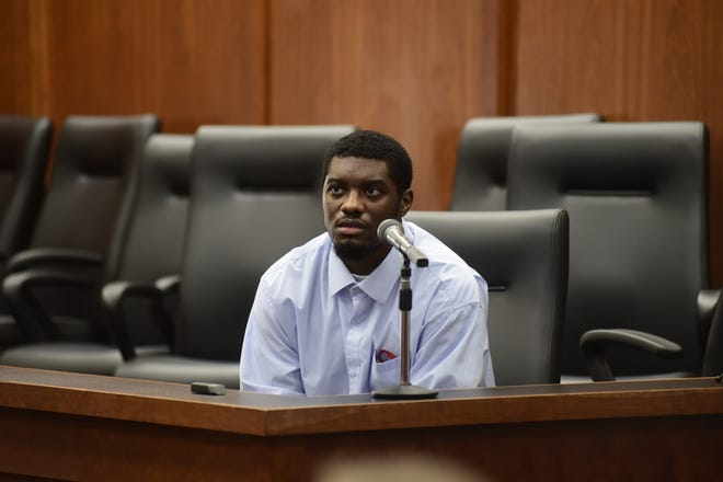 Chekiah Washington listens to questions Friday from the witness stand.