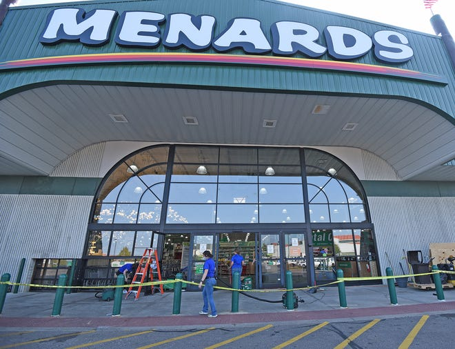 Menards' employees clean up Friday morning after someone first 15 rounds into the store's windows. Police say they have no suspect yet.