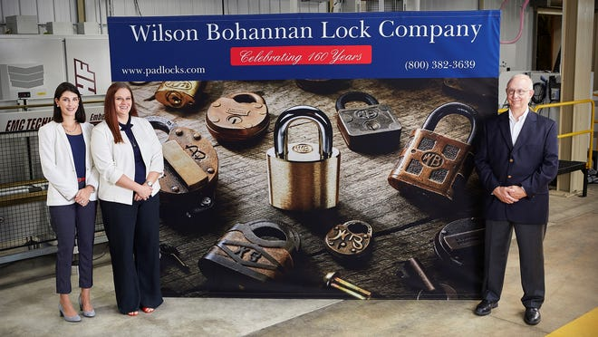 The Wilson Bohannan Lock Company of Marion will represent the state of Ohio at the White House Made in America Product Showcase on Oct. 5. The family-owned company is celebrating its 160th anniversary this year. President and CEO Howard Smith, right, is shown with his daughters, Sarah Rassell, far left, and Trish Smith in front of a sign commemorating the company's anniversary. Smith and his daughters represent the sixth and seventh generations of family ownership of Wilson Bohannan.