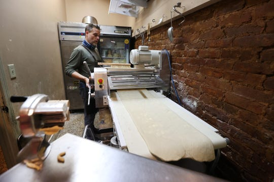 Raven & Lily Chef Justin Young flours yeasted puff pastry at his Collierville restaurant. where he has started making French pastries to add to the menu.