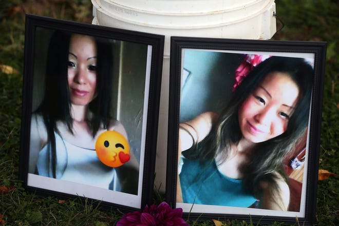Photographs of Ee Lee are seen at the site of a candlelight vigil at Washington Park Lagoon on Thursday, Sept. 24, 2020. A crowd of about 50 wrote messages on balloons and lit candles to honor her memory.