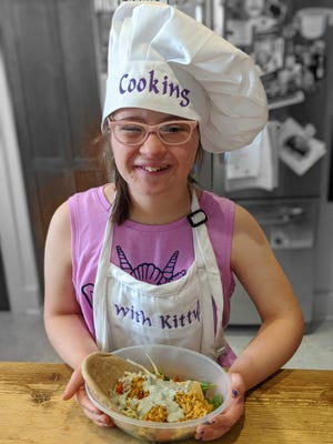 "Kitty Storey, 13, of Wauwatosa is the star of the YouTube show ""Cooking with Kitty."""