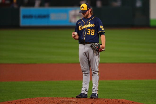 Brewers starting pitcher Corbin Burnes stands on the mound after giving up a two-run home run to the Cardinals' Dylan Carlson in the fourth inning.