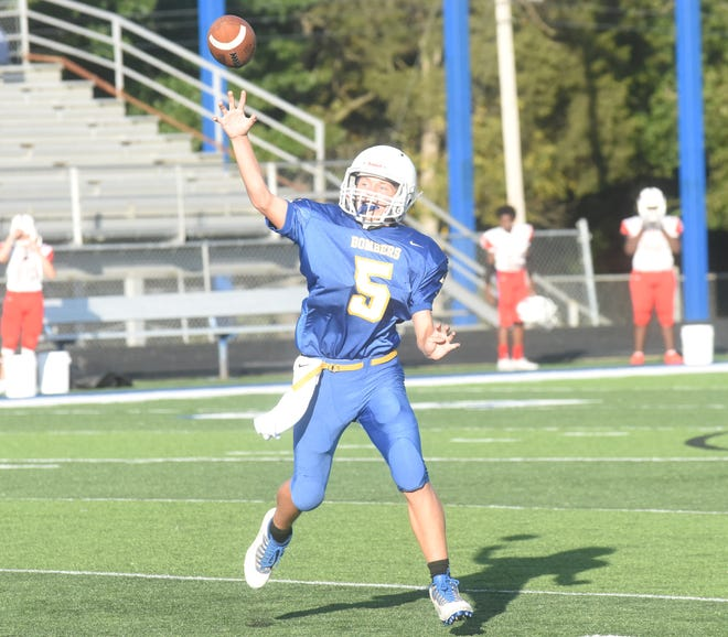 Mountain Home quarterback Cade Yates throws a pass during the Junior Bombers' 47-12 victory over Marion on Thursday night.