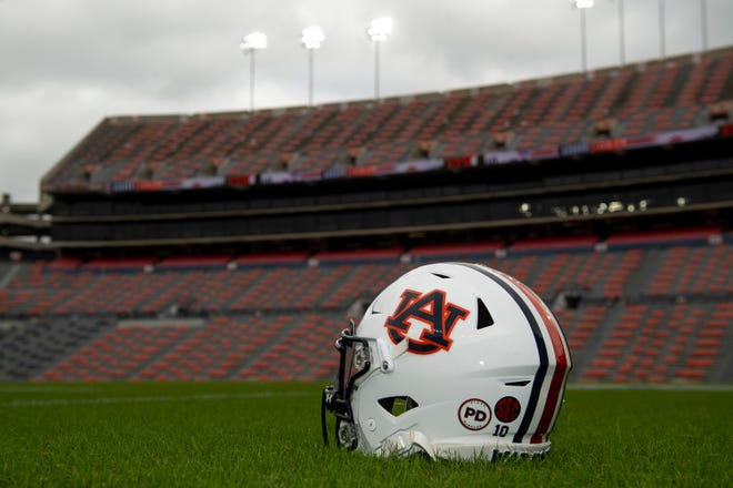 "An Auburn helmet with a ""PD"" decal honoring Pat Dye."