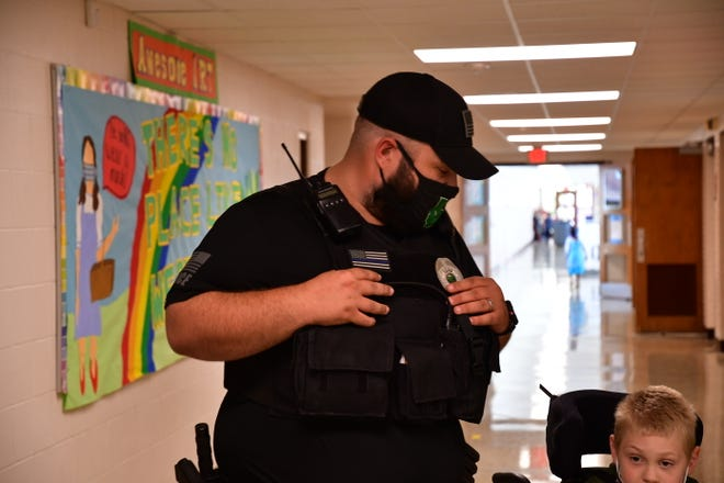 School Resource Officer Aaron Brooks interacts with a student at West View Elementary School in Muncie.