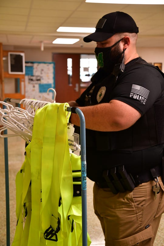 School Resource Officer Aaron Brooks works on a task at West View Elementary School in Muncie.