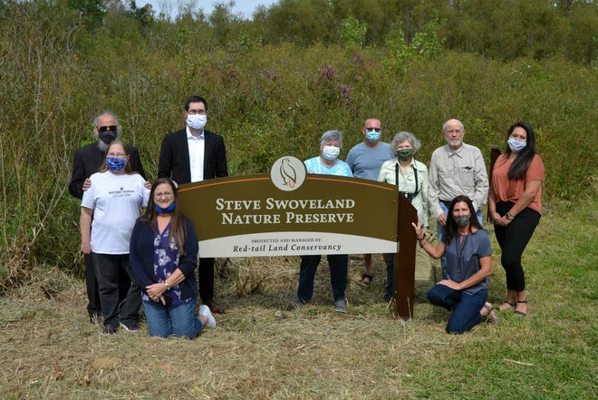 The family of the late Steve Swoveland poses around new trailhead signage for the renamed Hagerstown Nature Preserve, now the Steve Swoveland Nature Preserve.
