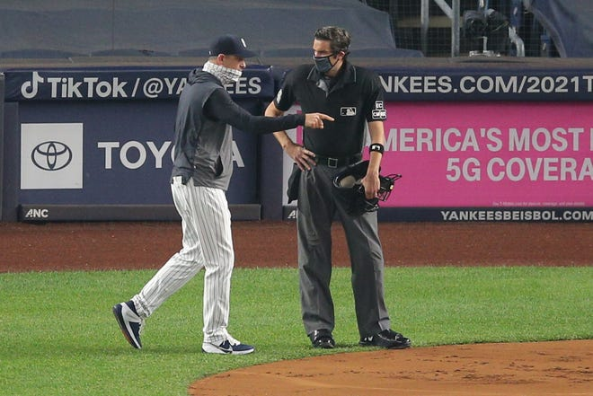 Sep 25, 2020; Bronx, New York, USA; New York Yankees manager Aaron Boone argues with home plate umpire John Tumpane (74) during the first inning against the Miami Marlins at Yankee Stadium. Mandatory Credit: Brad Penner-USA TODAY Sports
