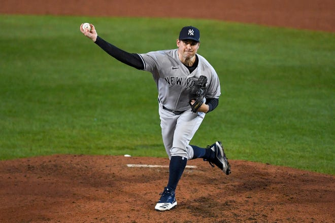 New York Yankees pitcher Adam Ottavino throws to a Toronto Blue Jays batter during the sixth inning of a baseball game in Buffalo, N.Y., Thursday, Sept. 24, 2020. (AP Photo/Adrian Kraus)