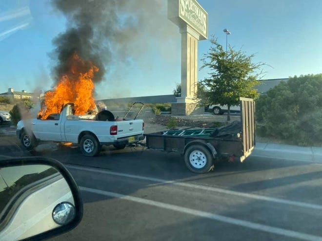 A pickup truck parked along Telshor Boulevard is engulfed in flames Friday, Sept. 25, 2020.