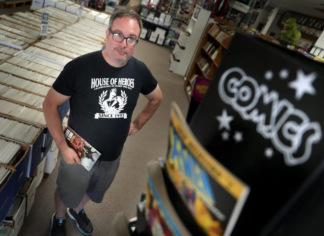 House of Heroes owner Scott Dercks poses for a photo Tuesday, Sept. 22, 2020, at his store, 407 N. Main St., Oshkosh. House of Heroes marked its 25th year in business in September.