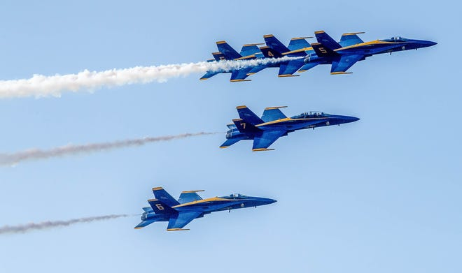 The U.S. Navy Blue Angels do a flyover around the Pensacola area on Sept. 25, 2020, to lift spirits in the community in the aftermath of Hurricane Sally.