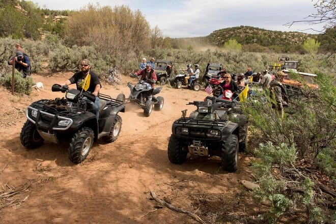 In this May 10, 2014, file photo, people ride ATV's into Recapture Canyon north of Blanding, Utah, in a protest against what demonstrators called the federal government's overreaching control of public lands. (Trent Nelson/The Salt Lake Tribune via AP, File)