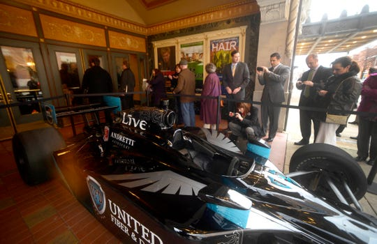 In this file photo from Feb. 28, 2013, fans take photos of a race car with the multi-platinum-selling rock band Live's logo on it in front of what was then called the Strand-Capitol Performing Arts Center in York. Bill Hynes and three members of Live, Chad Taylor, Chad Gracey and Patrick Dahlheimer, introduced their telecommunications startup, United Fiber & Data, at the elaborate news conference.