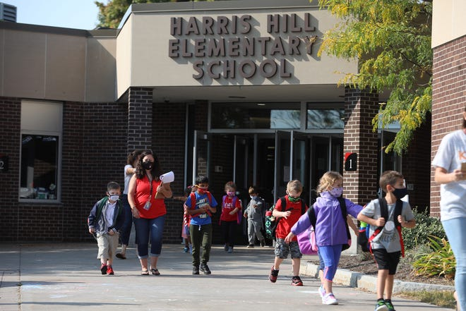 Students leave for the day Harris Hill Elementary School in Penfield on Sept. 25, 2020.