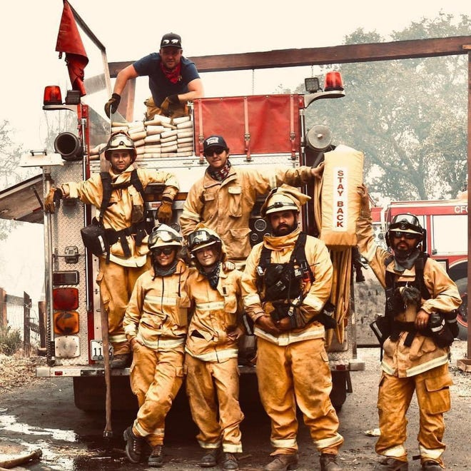 Yancey Cabrera (bottom row, second from right) was on the front lines defending the same place he experienced a near-fatal car wreck years earlier.