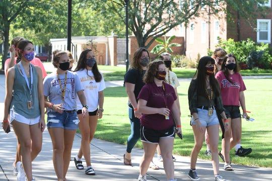 Salisbury University students wear masks throughout campus.