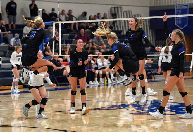 Sioux Falls Christian celebrates as they win their volleyball match against Dakota Valley in the fourth set on Thursday, September 24, at Sioux Falls Christian High School.