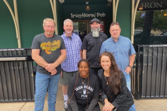 The staff of the Iron Horse Pub welcomed customers when the popular downtown Pub reopened Monday. From left, co-owner John Dickinson, Director of Operations Jimmy Cooper, General Manager Ronny Berry and Co-owner Danny Ahern. In the front row, from left, Assistant Manager Emily Craft and recently hired server Tazz Cooper.