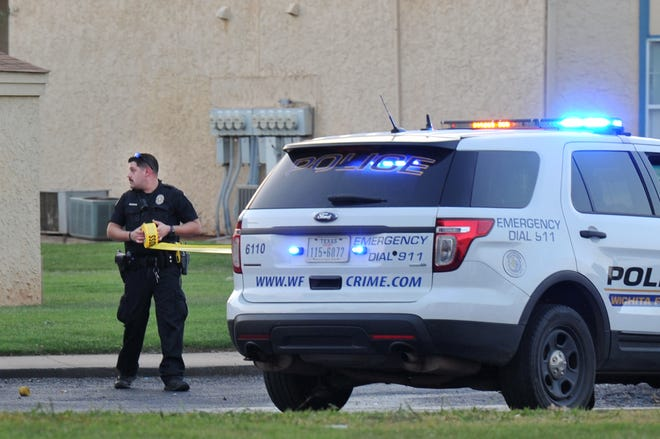 Wichita Falls police work the scene of a reported shooting Thursday night at Highpoint Village Apartments.