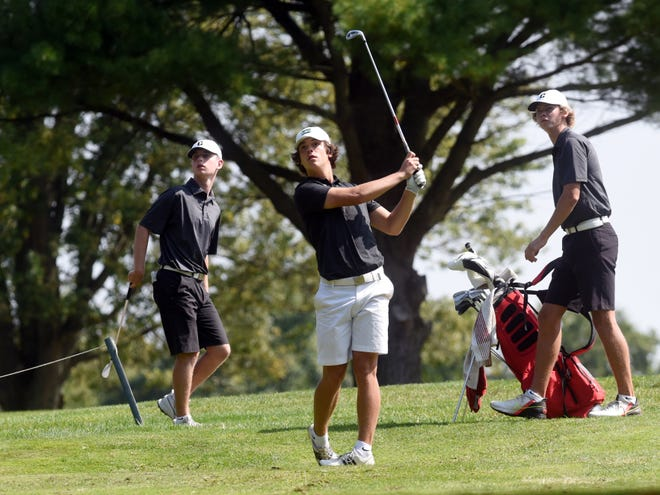 Crooksville's Owen Carney, left, and Blake White watch Drew Johnson, of Tri-Valley, tee off during the Muskingum Valley League Tournament on Friday at Jaycees. Crooksville won the event in a scorecard playoff over Tri-Valley after both finished with 316.