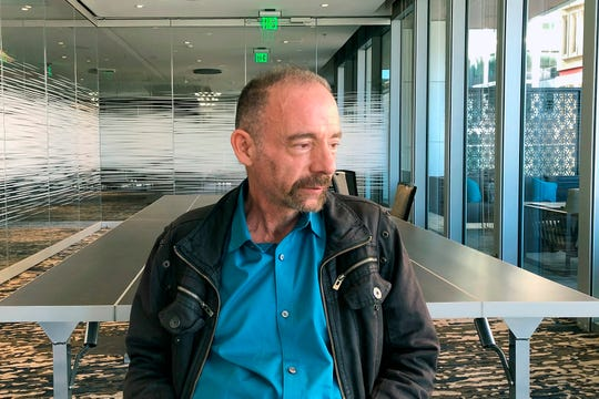 In this Monday, March 4, 2019 file photo, Timothy Ray Brown poses for a portrait in Seattle.  Brown, an American who was known for years as the Berlin patient, had a transplant in Germany from a donor with natural resistance to the AIDS virus. It was thought to have cured Brown's leukemia and HIV. But in an interview Thursday, Sept. 24, 2020, Brown said his cancer returned last year and has spread widely.