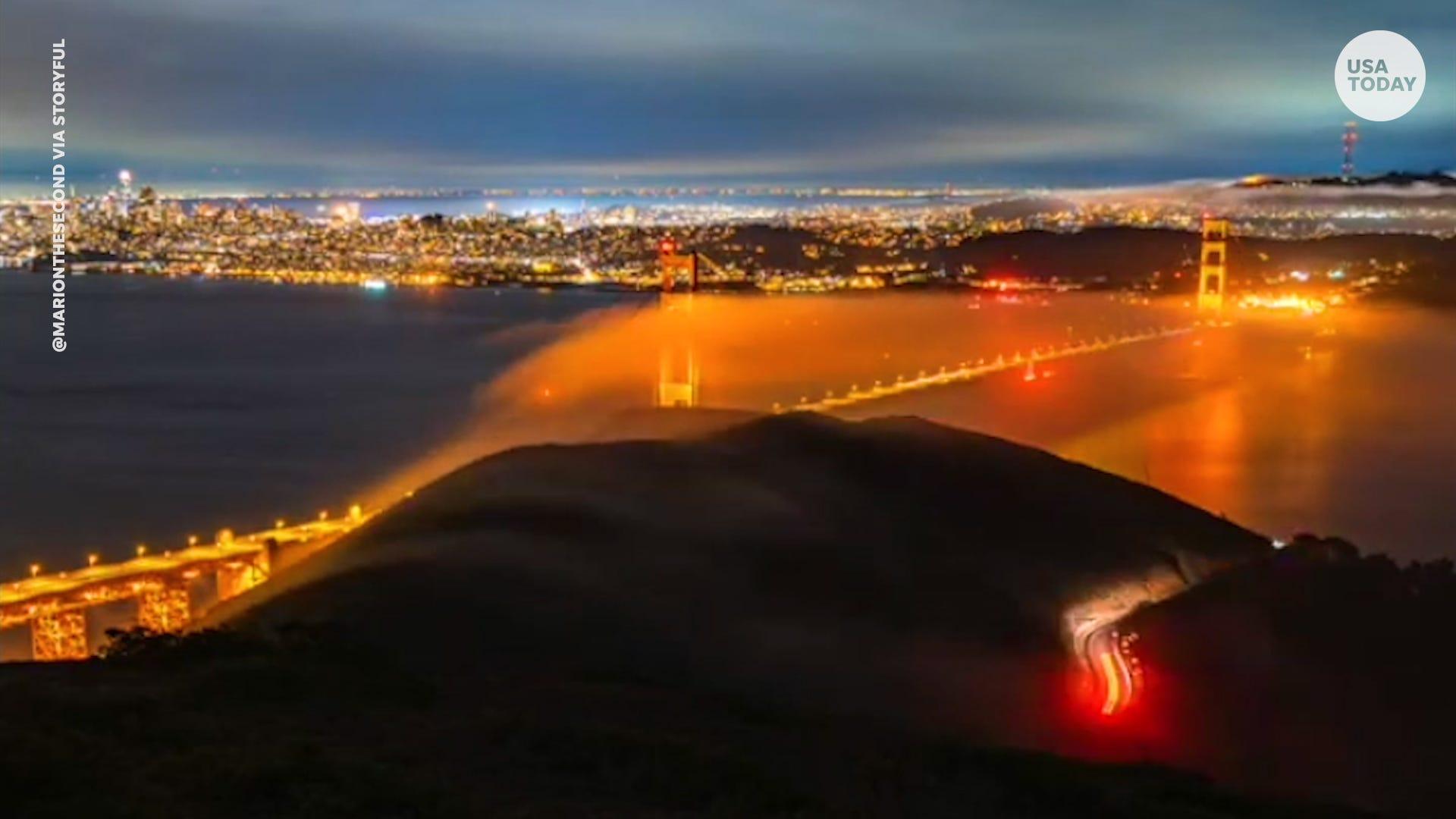 Time lapse: Golden Gate Bridge glows behind foggy San Francisco bay