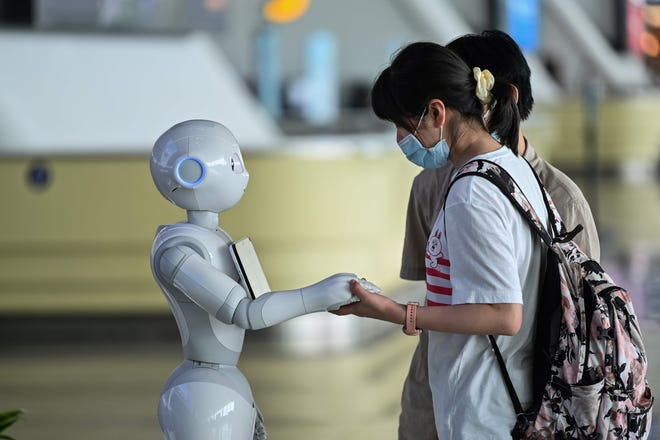 Robots roam airports reminding passengers to put their masks on.