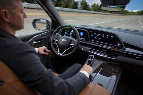 Cadillac's Super Cruise technology gets revamped in the 2021 Cadillac Escalade, out this year, including automatic lane changes, and more. Unlike Tesla's Autopilot, you don't need your hands on the wheel but need to be looking at the road.