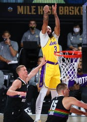 Anthony Davis shoots during the first half of the Lakers' Game 4 win against the Denver Nuggets.