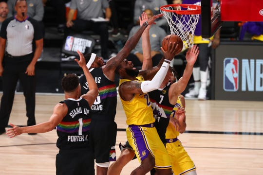 Los Angeles Lakers forward LeBron James is fouled during the first half of Game 4 against the Denver Nuggets.