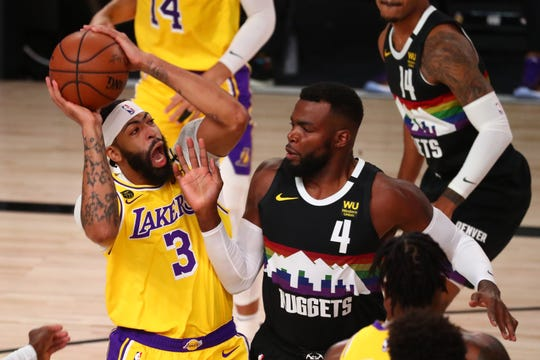 Los Angeles Lakers forward Anthony Davis shoots over Denver Nuggets forward Paul Millsap during the first half of Game 4 of the Western Conference finals.
