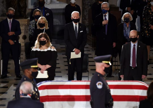 The death in September of liberal Associate Justice Ruth Bader Ginsburg, here being mourned by Joe Biden during the 2020 presidential campaign, eliminated the president-elect's opportunity to maintain a smaller 5-4 conservative majority on the Supreme Court.