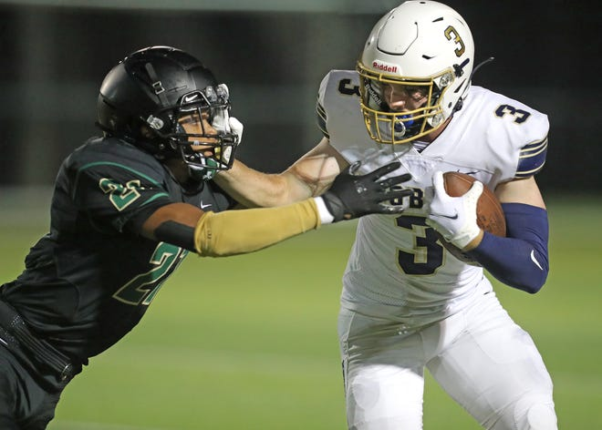 St. Vincent-St. Marys D'Anthony Kelker moves in to make the tackle on Hoban's Brayden Fox during the third quarter on Friday, Sept. 25, 2020  in Akron, Ohio at John Cistone Field.  [Phil Masturzo/ Beacon Journal]
