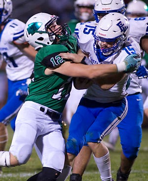 West Branch's Tanner Egli tackles East Liverpool's Devin Toothman in a non-conference game at Clinton Heacock Stadium Friday, September 25, 2020.