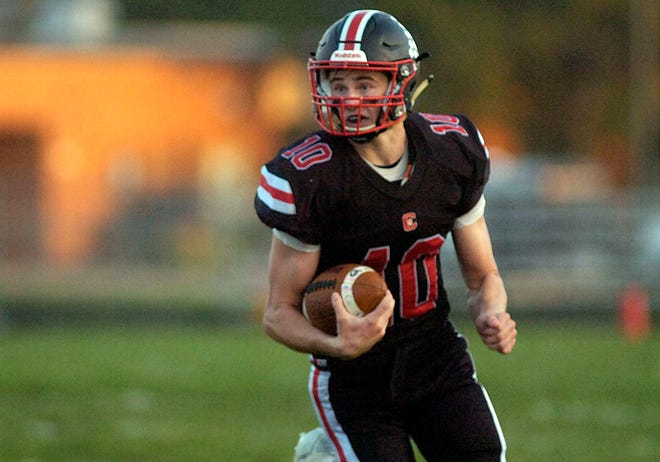 Crestview's Ross Kuhn (10) runs the ball against South Central Friday night at Crestview High School. Kuhn broke the school single-game record for touchdown passes in the Cougars' 55-7 win.
