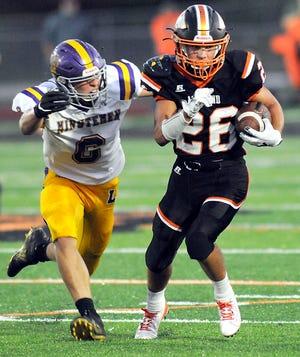 Ashland High's Jayden Jones (26) runs with the ball during a high school football game against Lexington on Sept. 25, 2020 at Ashland Community Stadium.