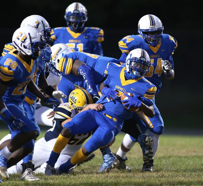 Cornell's Timothy Henderson (7) gets ripped to the ground by Shenango's Alex Suber (62) during the first half Friday night at Cornell High School.
